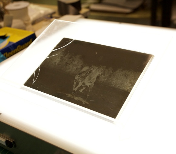 Broken glass plate negative on a light table. Photo Credit: Yesan Ham.