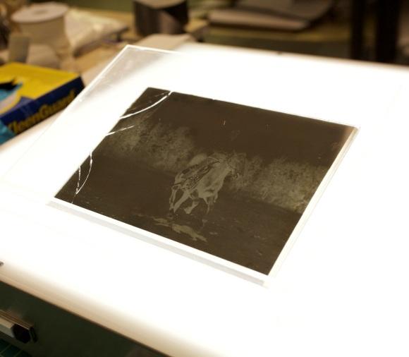 Broken glass plate negative on a light table. Photo Credit: Yesan Ham.